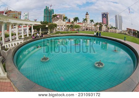 Kuala Lumpur, Malaysia - August 29, 2009: View To The Buildings At The Independence Square Reflected