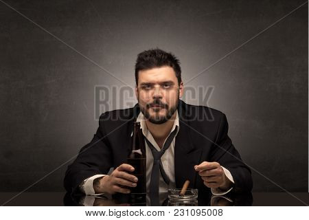 Young drunk man at his office with free dark copyspace