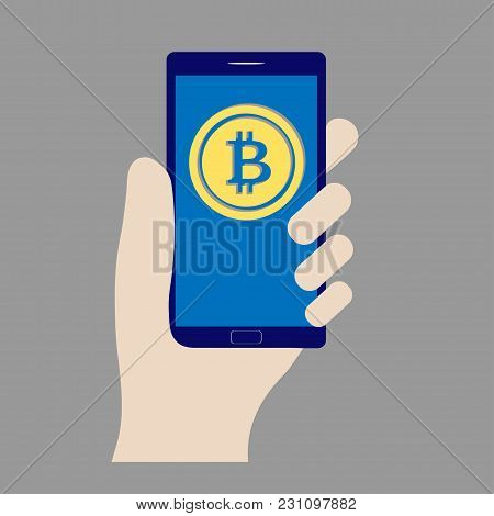 Hand Holding A Smartphone With Bitcoin Symbol On It