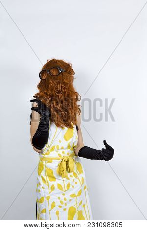 Anonymous Faceless Housewife Wearing An Apron Over An Evening Dress And Evening Gloves Wig Upside Do