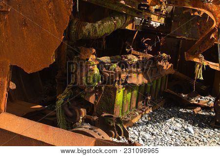 Rusted Engine Of A Wrecked Pusher Boat