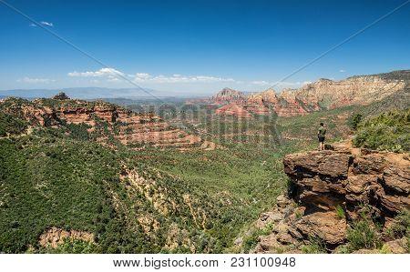 Hiker Standing At The Schnebly Hill Vista Overlook Near Sedona, Arizona