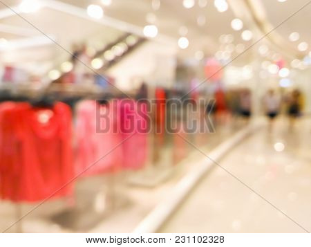 Blurred Clothing Storefront Window Display In Shopping Center Background