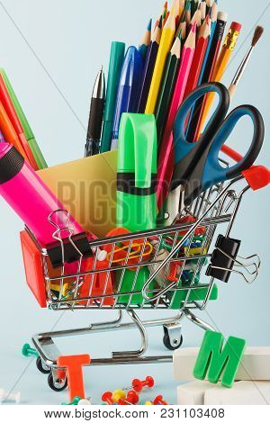 Shopping Cart With Different Stationery, Light Blue Background