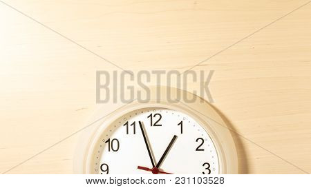Clock Hanging On Wall Ticking Showing One Hour
