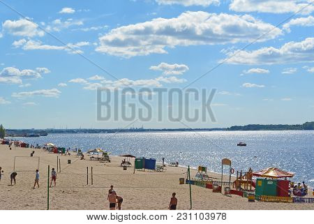 Samara, People On City Beach On The Shores Of The Volga River. Beautiful Cumulus Clouds On Blue Sky