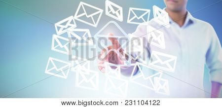 Man pretending to touch an invisible screen against white background against abstract blue background