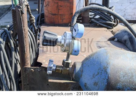 Gas Welding Equipment. A Cylinder With Propane And A Cylinder With Oxygen.