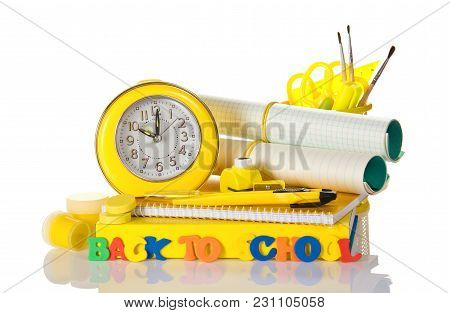 Set Of School Supplies, An Alarm Clock And An Inscription Back To School, Isolated On White Backgrou