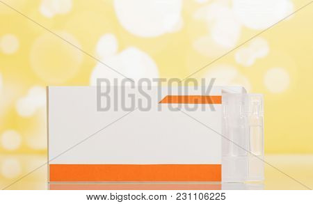 Cardboard Box With Solution For Inhalation In Ampoules, On Yellow Background