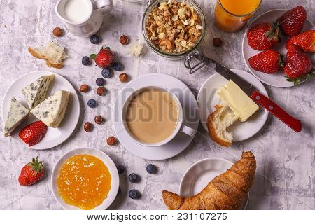 Healthy Morning Breakfast  Served  With  Granola, Coffee, Butter, Jam, Fresh Strawberry, Fruit Juice
