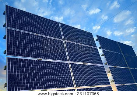 3d Rendering Of Solar Panels Agains A Blue Sky