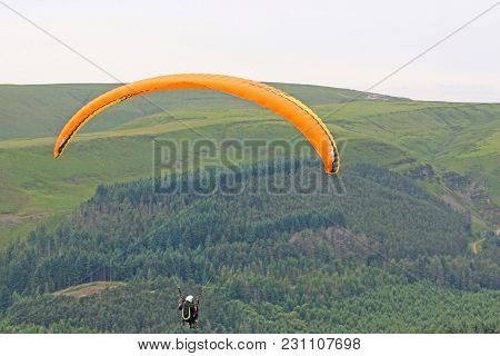 Tandem Paraglider Flying In The Brecon Beacons, Wales