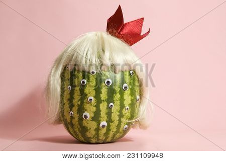 Freak Watermelon Wearing A Wig And Crown On A Pink Background