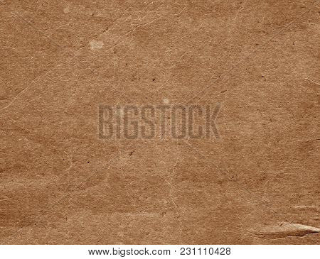 Old Brown Cardboard Surface. Abstract Background And Texture For Design And Ideas.