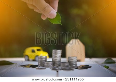 Saving To Buy A House Or Car Savings Concept With Money Coin Stack Growing.saving Money Concept.