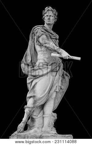 Roman emperor Julius Caesar statue isolated over black background