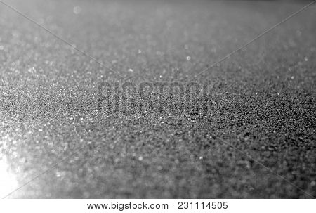 Frost And Snow With Blur Effect On Sun In Black And White. Abstract Background And Texture For Desig