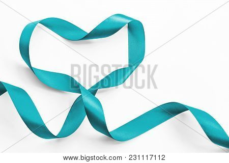 Teal Ribbon Awareness In Heart Shape Isolated On White (clipping Path) Symbolic Bow Color For Ovaria