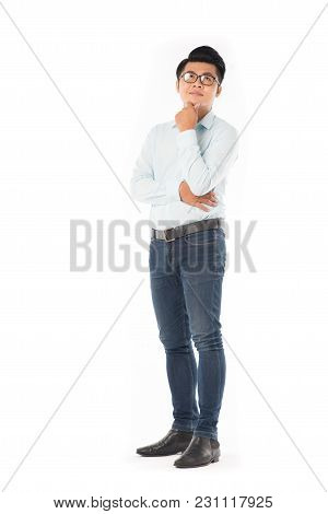 Portrait Of Young Asian Businessman Wearing Eyeglasses On White Background