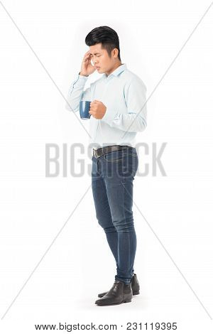 Young Asian Man Holding Mug With Hot Drink On White Background