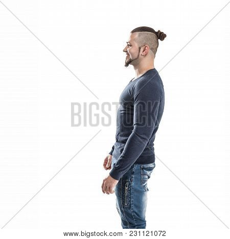 Side View - The Sports Guy - A Bodybuilder In Jeans And A T-shirt On A Light Background . The Photo