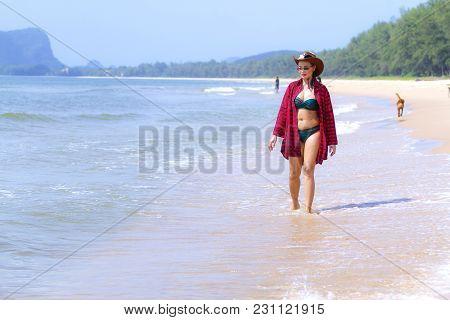 Women Shape Pretty And Bikini Daylight On Beach At Bang Beot Beach, Chumphon Province Thailand