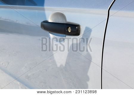 A Hand With A Bottle Of Alcohol Opens The Door Of The Car.