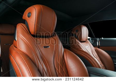 Modern Luxury Car Inside. Interior Of Prestige Modern Car. Comfortable Leather Red Seats. Orange Per