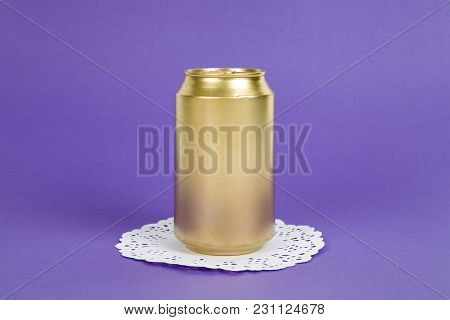 An Unused Can Painted In Gold On A Virant Colored Background. Minimal Color Still Life And Quirky Ph
