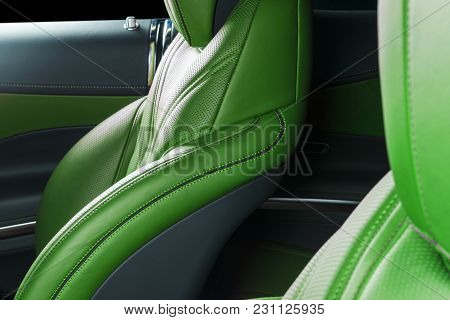 Modern Luxury Car Inside. Interior Of Prestige Modern Car. Comfortable Leather Red Seats. Green Perf