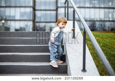 Cute Little Girl On A Walk In Town.