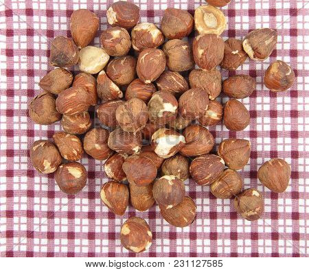 Colorful And Crisp Image Of Hazelnuts On Cloth Background