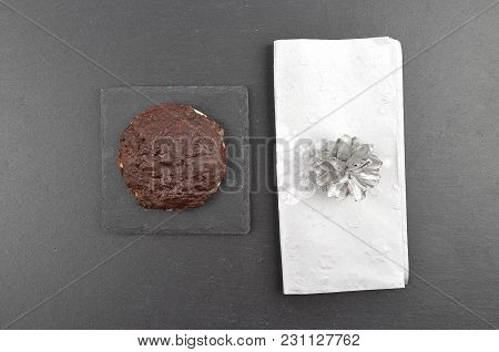 Colorful And Crisp Image Of German Lebkuchen With Christmas Napkin On Slate
