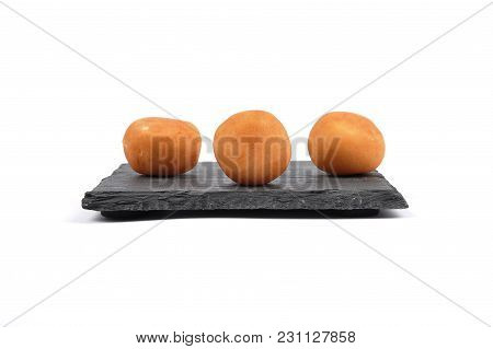 Colorful And Crisp Image Of Marzipan Potatoes On Shale Board