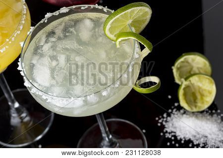 High Angle View Of A Lime Margarita Cocktail With Tequila, Triple Sec, Lime Juice, Crushed Ice And S