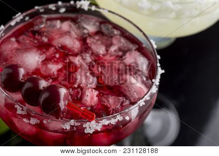 High Angle View Of A Cherry Margarita Cocktail With Tequila, Cherry Juice, Crushed Ice And Some Salt