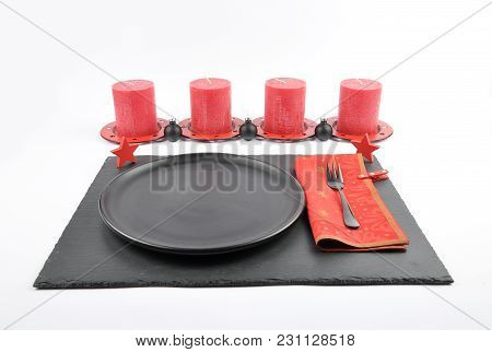 Colorful And Crisp Image Of Christmassy Table Setting With Shale And Candles