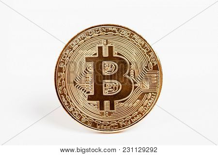 Golden Bitcoin Cryptocurrency on white background. New Virtual money concept.