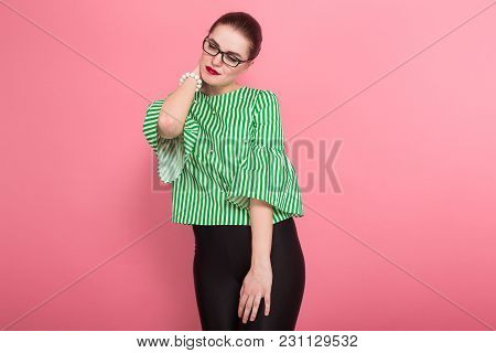 Portrait Of Attractive Businesswoman With Hair Bun In Striped Blouse And Eyeglasses Suffering From N
