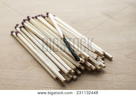 Burnt And Whole Head Long Wooden Safety Matchsticks On Wooden Background