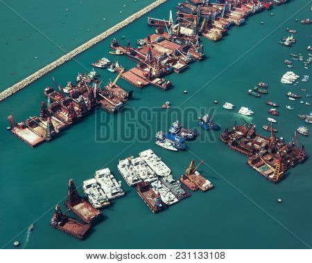 Hong Kong - October 2017: Elevated view of port with docking crane vessels.