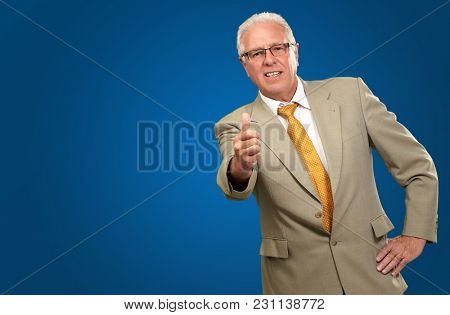 Happy Business Man Showing Thumb Up Sign On Blue Background