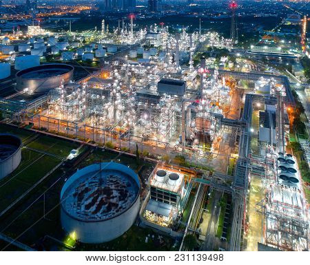 Aerial View Of Twilight Of Oil Refinery ,shot From Drone Of Oil Refinery And Petrochemical Plant At