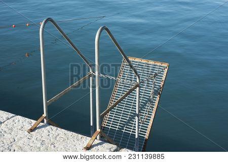 Metallic Handrails And Hanged Ladder On Sea Pier