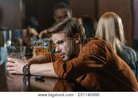 Very Drunk Caucasian Man With Automobile Keys At Bar With Friends
