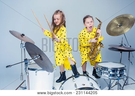 Teen Music Girls Performing In A Recording Studio. The Group Of Two Girls Standing Together. Studio