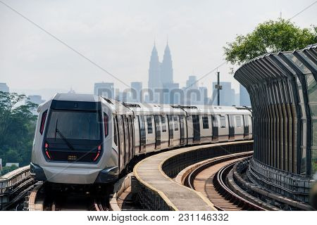 Mass Rapid Transit (mrt) Train With Background Of Cityscape In Kuala Lumpur. Mrt System Forming The
