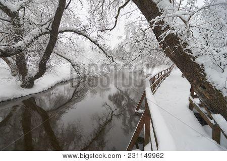 Beautiful Winter Scene On Yauza River And Wooden Walkway After Heavy Snowfall, Babushkinkiy District