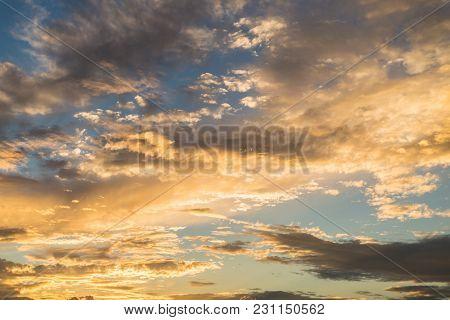 Beautiful Golden Sky Clouds Sunset. Setting Sun Illuminates The Clouds.